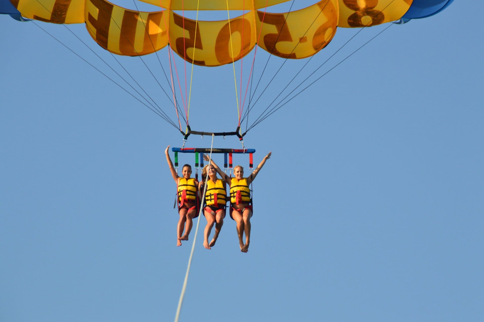 Tourists enjoying parasailing with Miami Watersports